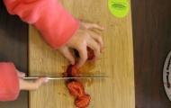 Cutting strawberries.